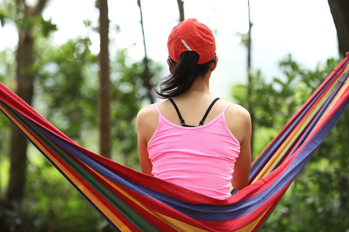 Relaxing in hammock in summer forest